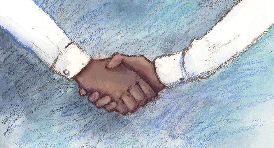 Two hands in white dress shirts shaking hands.