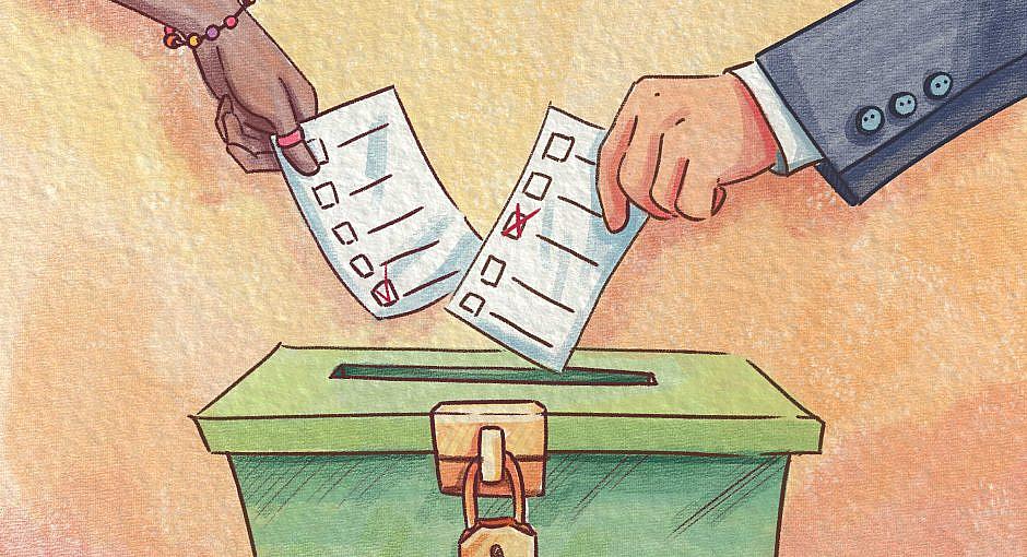 Two hands putting ballots or surveys into green ballot box